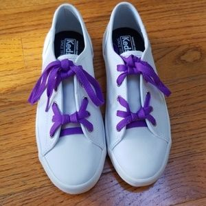 Keds white leather with purple laces.
